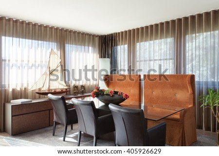 Interiors of new apartment , dining room furnished classical - stock photo