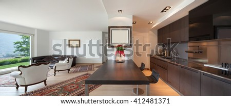 Interiors of new apartment, wide open space with kitchen and living room - stock photo