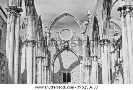 Interiors of the roofless Carmo Convent in Lisbon - stock photo
