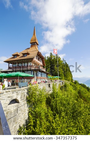 INTERLAKEN, SWITZERLAND - SEPTEMBER 07, 2015: Harder Kulm Panorama Restaurant located high up on mountain at 1322 meters above sea level offers a unique view of the world-famous Alpine peaks - stock photo