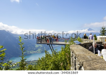 INTERLAKEN, SWITZERLAND - SEPTEMBER 07, 2015: The viewing platform placed on altitude of 1322m at Harder Kulm, provides scenic views of the city, two lakes, the river Aare and beautiful alpine peaks - stock photo
