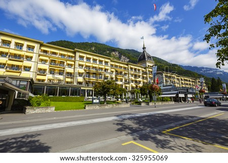 INTERLAKEN, SWITZERLAND - SEPTEMBER 07, 2015: Victoria Jungfrau Grand Hotel & Spa, dating to 1865 belongs to a group of Swiss Deluxe Hotels, offers 224 elegantly furnished rooms in various styles - stock photo
