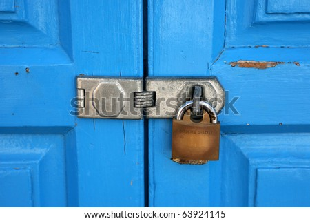 interlock on a blue wooden door secured with a padlock & Interlock On Blue Wooden Door Secured Stock Photo (Royalty Free ...