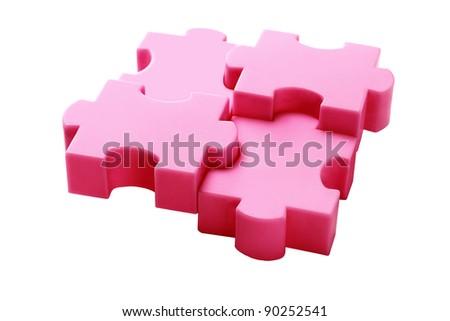Interlocked Plastic Jigsaw Puzzle Blocks On White Background - stock photo