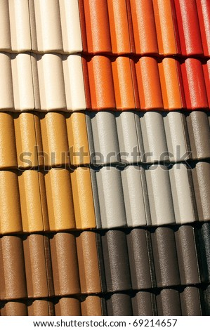 Interlocking Coloured Roof Tiles on display. Replacement roofing. Could be Terracotta roof tiles, concrete tiles, or clay roofing. - stock photo