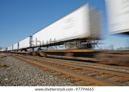 Intermodal train speeding down the tracks - stock photo