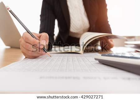 Internal Auditor verify the accuracy of the information in the financial budget.  - stock photo