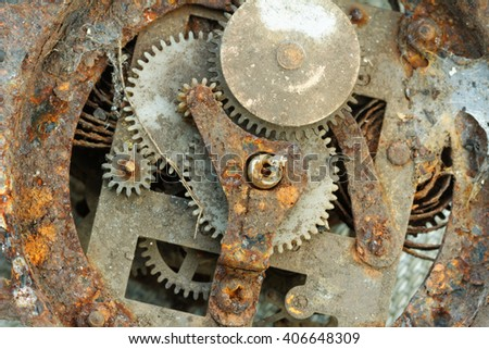 Internal part of an old clock. Rusty, damaged and abandoned. Showing the machinery inside the clock. - stock photo