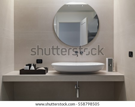 internal shots of a modern bathroom in foreground of counter top washbasin  whose walls are coated. Internal Shots Modern Bathroom Foreground Counter Stock Photo