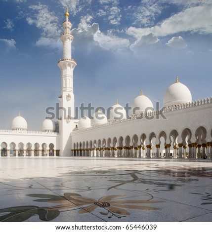Internal view of shiekh zayad mosque with artistic mosaic floor. Sheikh Zayed mosque in Abu Dhabi is the third largest mosque in the world. - stock photo