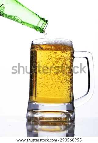 international beer days with pouring beer into glass - stock photo