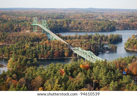 International bridge between USA and Canada in Thousand Islands Region in fall, New York State, USA - stock photo