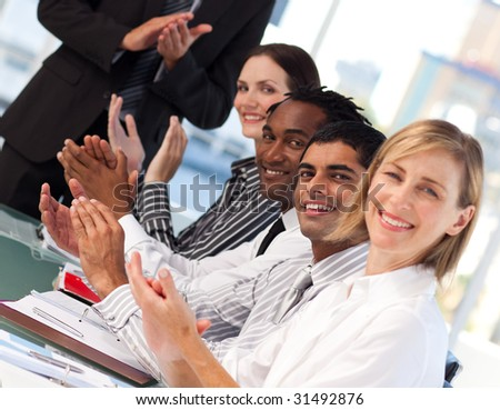 International business people applauding after a presentation - stock photo