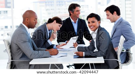 International business people discussing a new strategy in a meeting - stock photo