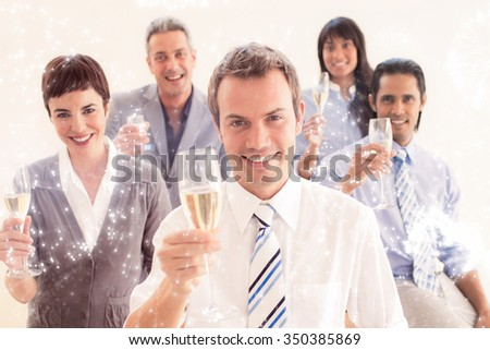 International business people toasting with Champagne against white fireworks exploding on black background - stock photo