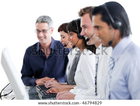 International business people using headset in a call center - stock photo