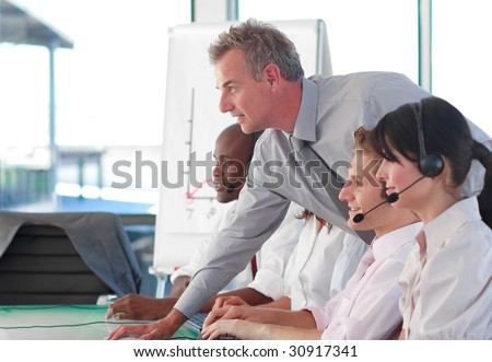 International business people working in a call center - stock photo