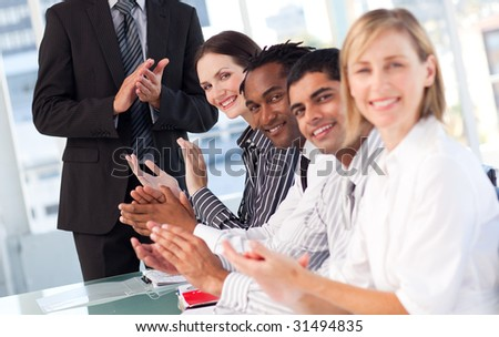 International business team clapping in a meeting