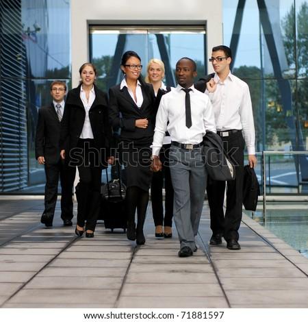 International business team over modern urban background - stock photo