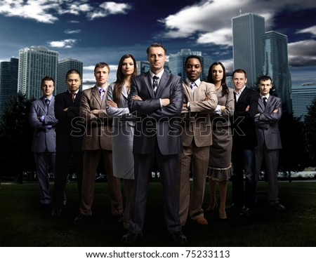 International business team over modern urban background - stock photo