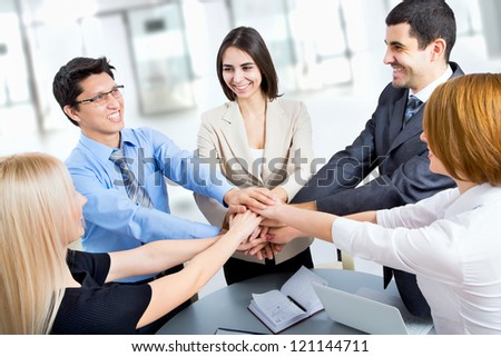International  business team showing unity with their hands together - stock photo