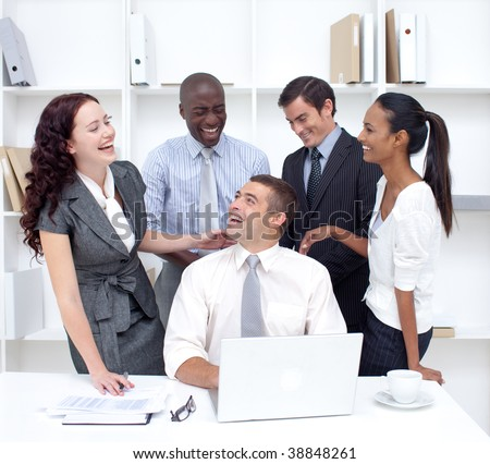 International business team working and having fun in office - stock photo