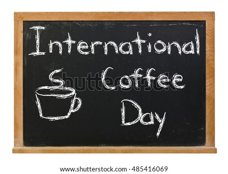International Coffee Day with a cup written in white chalk on a black chalkboard isolated on white