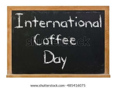International Coffee Day written in white chalk on a black chalkboard isolated on white