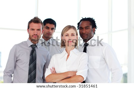 International confident business team looking at the camera - stock photo