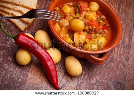 International Cuisine - Romanian Recipes - Country stew with vegetables and pork chops. - stock photo