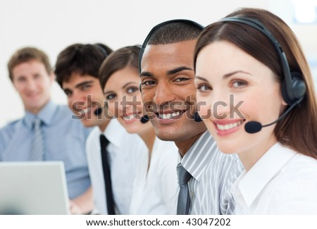 International customer service agents with headset on in a call center - stock photo