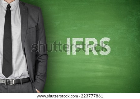 International financial reporting standards on green blackboard - stock photo