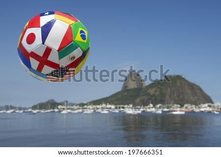 International flag football in the sky above Rio de Janeiro skyline - stock photo