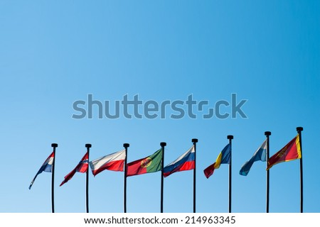 International Flags against blue sky background - stock photo