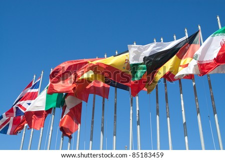International Flags blowing in the wind. - stock photo