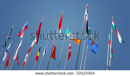 international flags on blue sky. symbol of  global world