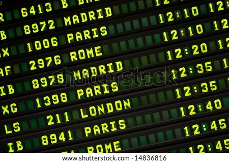 International Flight Information Board - stock photo