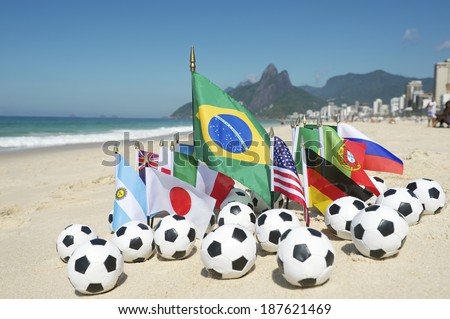 International football country flags with soccer balls on Ipanema beach in Rio de Janeiro Brazil