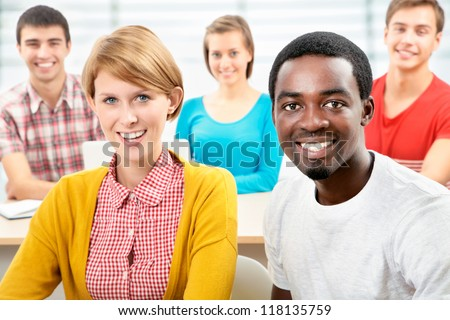 International group of students studying together in a university - stock photo