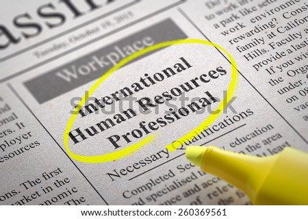 International Human Resources Professional Vacancy in Newspaper. Job Search Concept. - stock photo