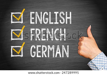 International Languages - English French German - Businesswoman with thumb up - stock photo