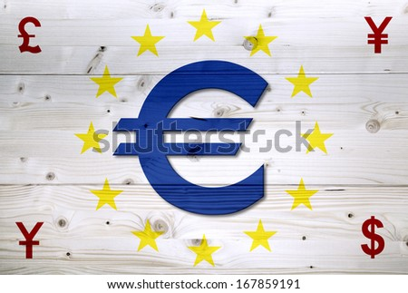 International red currency units around of European Union currency Euro on wooden background - stock photo