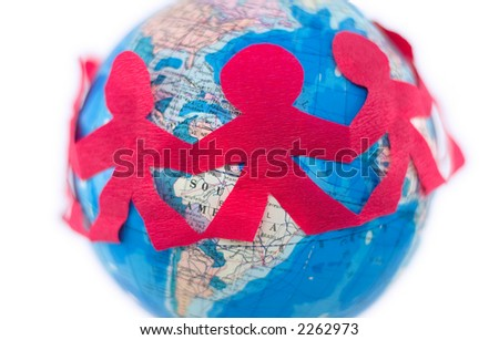 International relations - a chain of cut-out people stretched around the globe, photographed with shallow DOF - stock photo