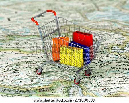International shopping. Colorful package in the shopping cart on the world map. World trade concept. - stock photo