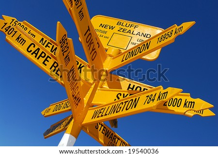 International signpost featuring various world capitals and their distances from Bluff in the far south of New Zealand.  (this is the world's southernmost signpost) - stock photo