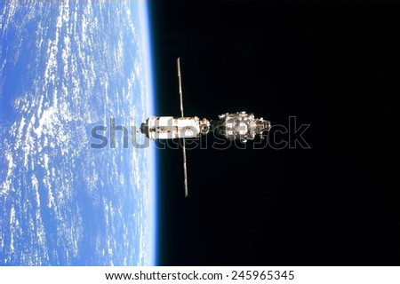 International Space Station in 1999. Photo taken from the Space Shuttle Discovery on June 3, 1999. - stock photo