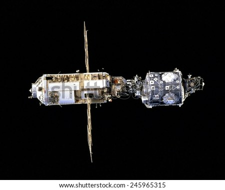International Space Station in 1998. The Russian made Zarya (left) docked with the US made Unity Module form the first phase of the International Space Station. - stock photo