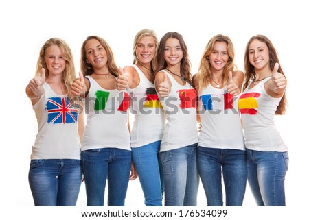 international teens with flags on t shirts - stock photo