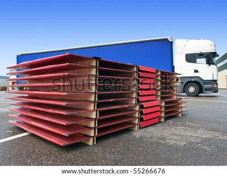 International transport concept, with a pallet ready to be loaded onto a waiting truck