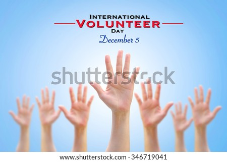 International Volunteer Day for Economic and Social Development conceptual idea: Many people blur hands raising upward on blue sky background showing vote, volunteering, participation, concept  - stock photo